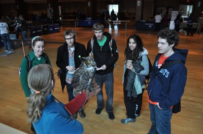 Penn State students admire a great-horned owl at the HUB