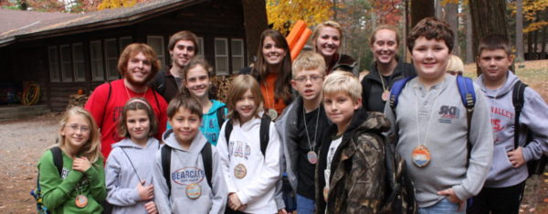 Group of happy Outdoor School campers and their counselors