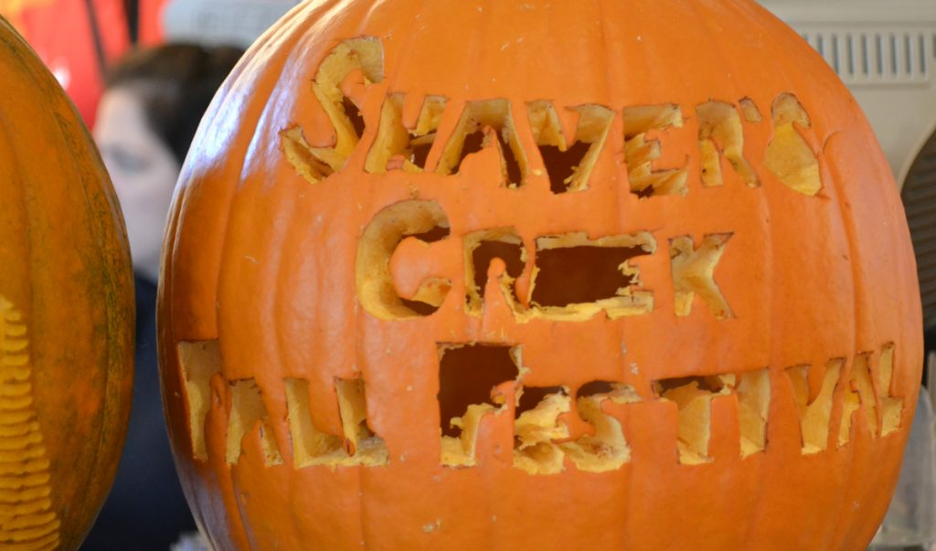 "A jack-o-latern carved with ""Shaver's Creek Fall Festival"""