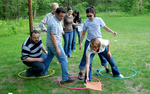 A group of Penn State employees participate in a team building exercise