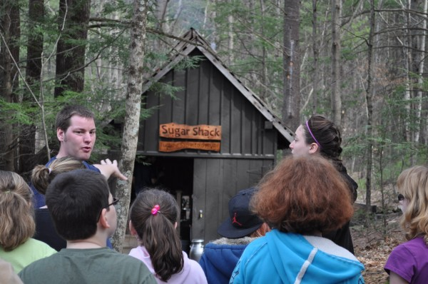 Guides at the Maple Harvest Festival show the sugar shack, where maple syrup is made.