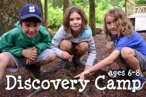 Discovery campers in the woods