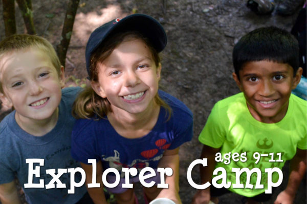 Three happy Explorer campers smiling up at the camera