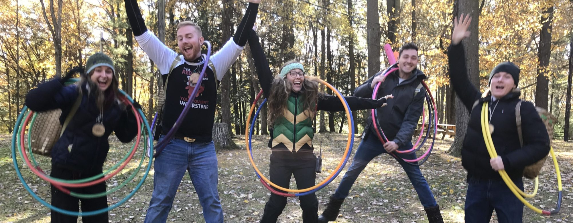 Five camp counselors with hula hoops