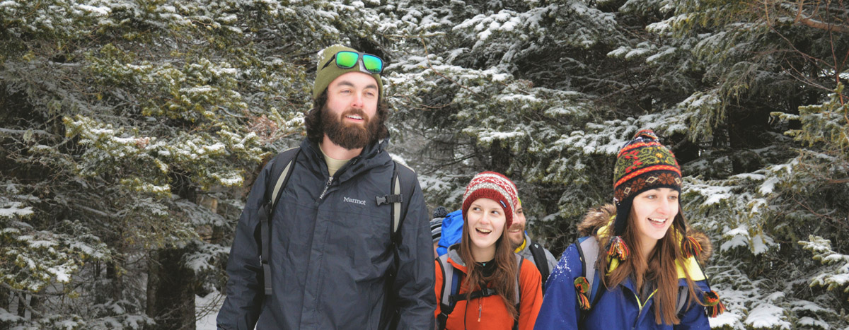 SEED Students Walking in a Snowy Forest